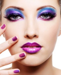 Beautiful young female face with bright fashion make-up